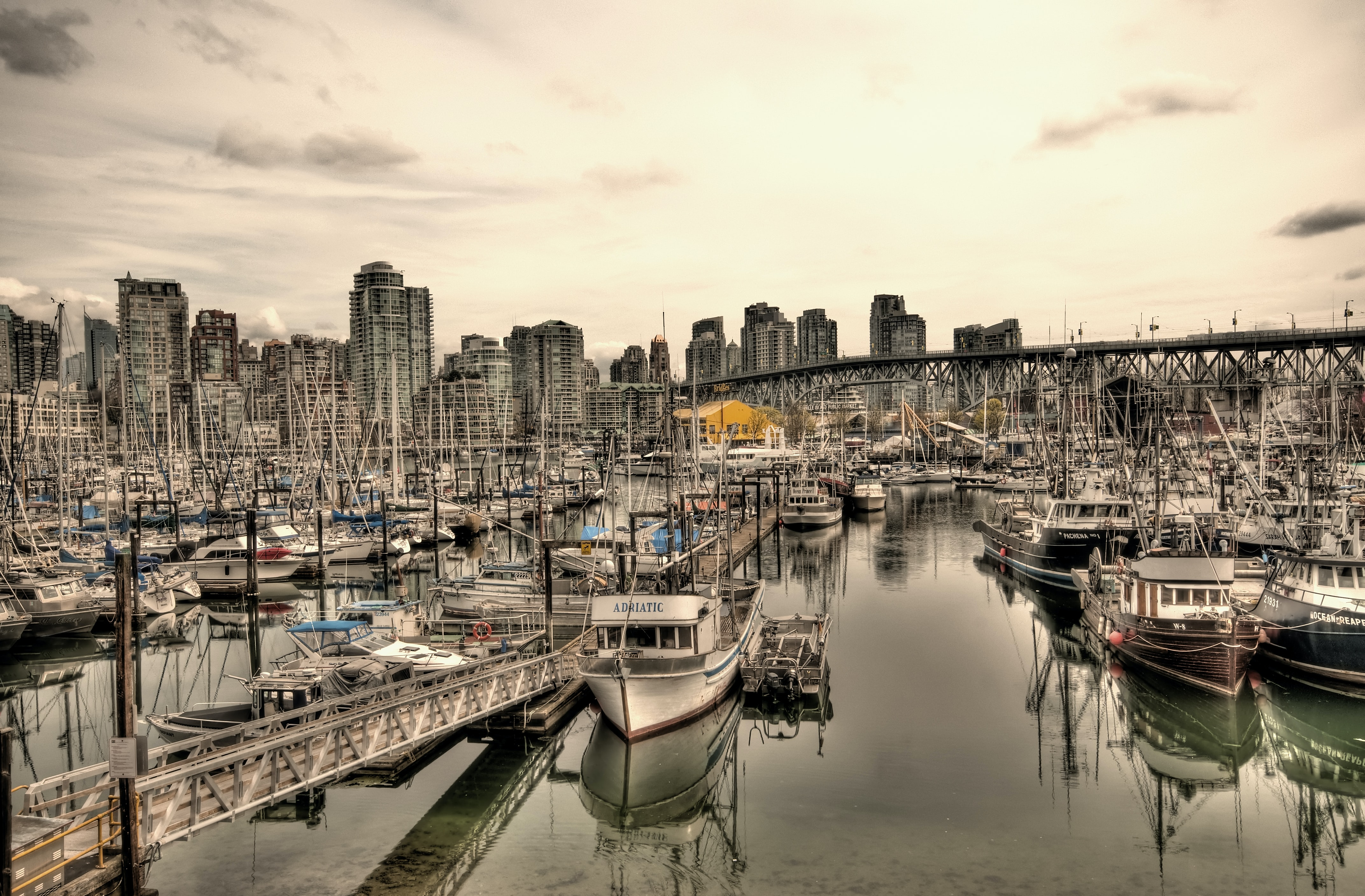 High contrast view of boats docked in a busy marina in Vancouver