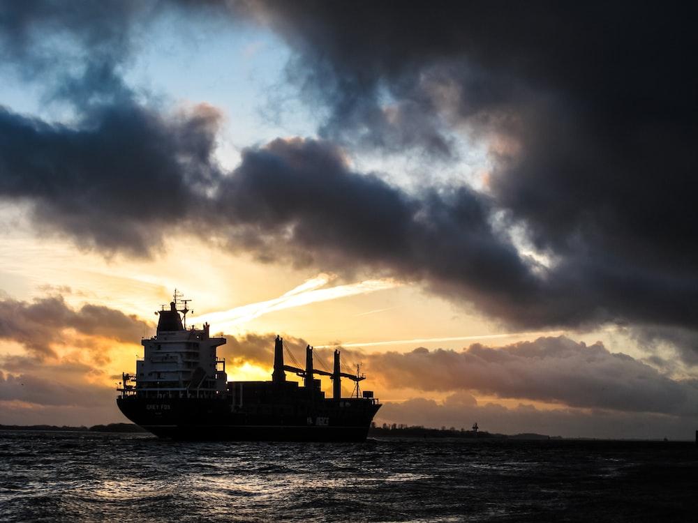 ship sailing during sunset