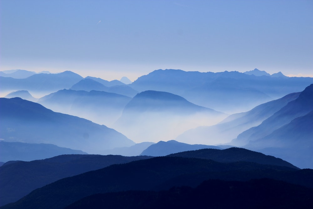 landscape photo of mountains with fog