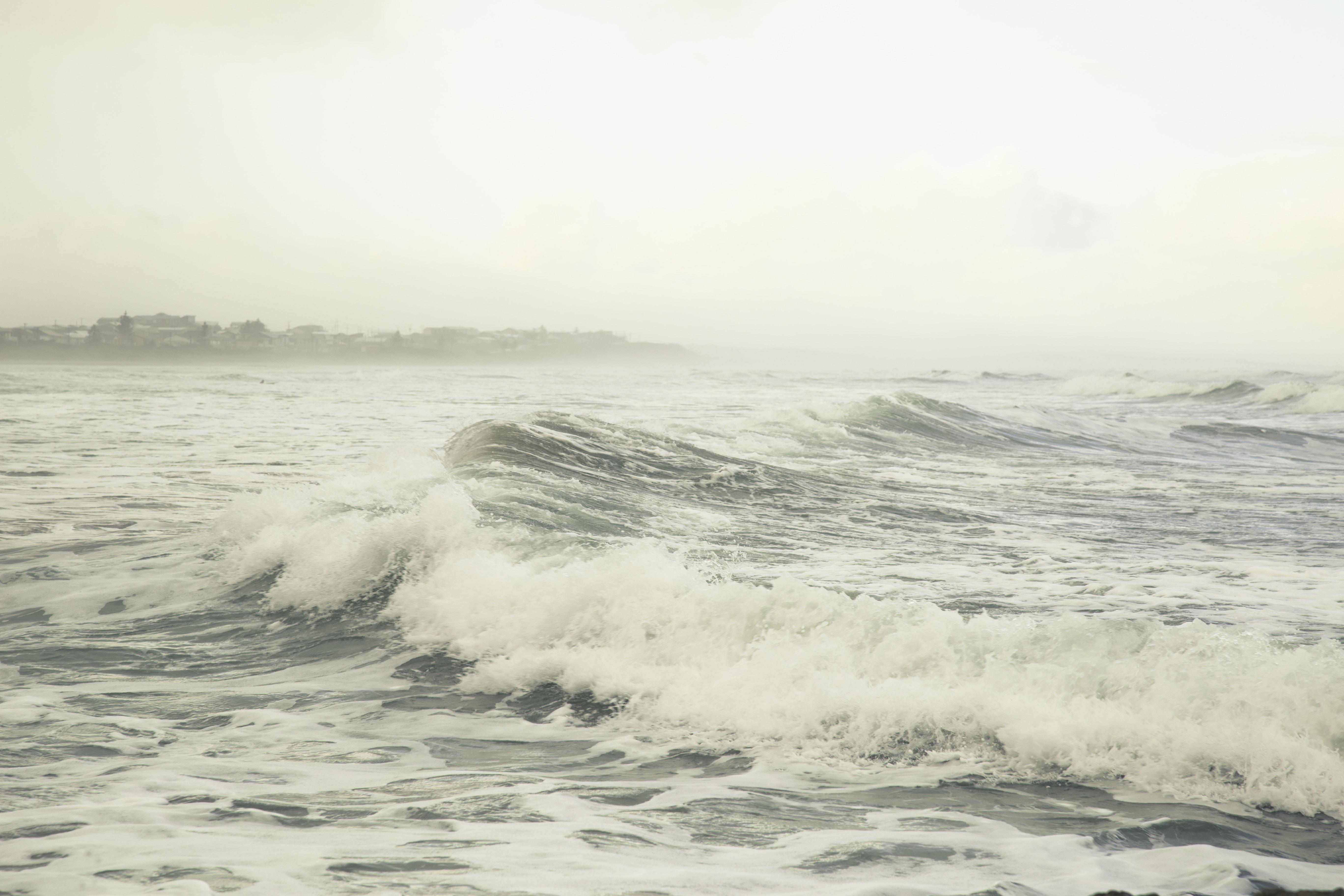 body of water under cloud