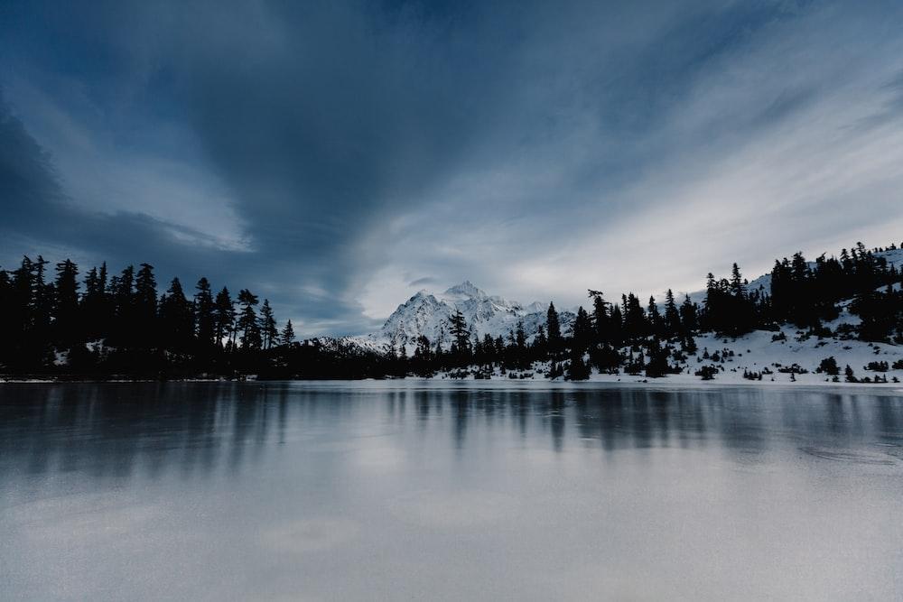 overlooking view of mountain under nimbus clouds