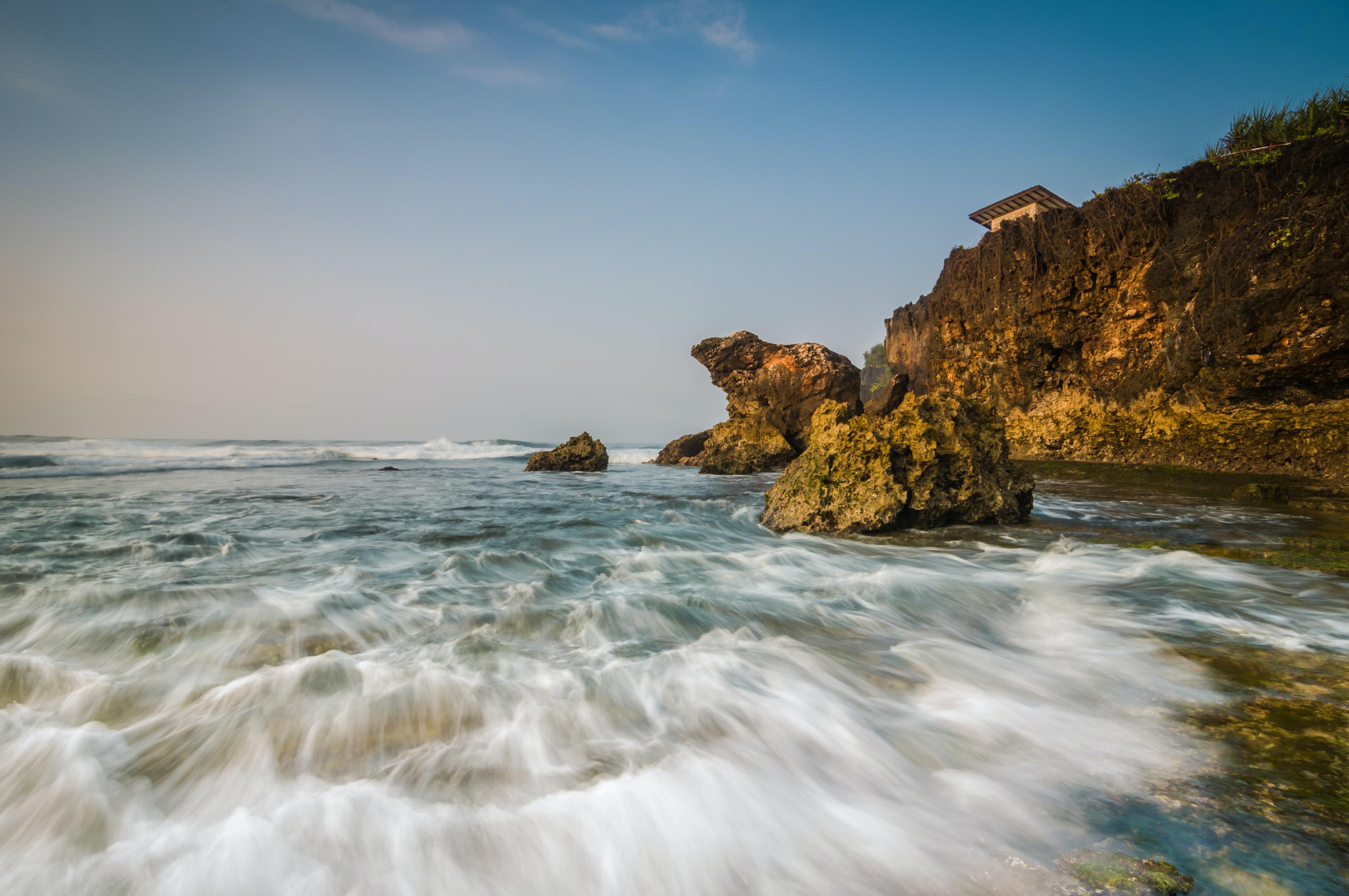 Long exposure photo of ocean washing on the rocky coast at Pantai Krakal