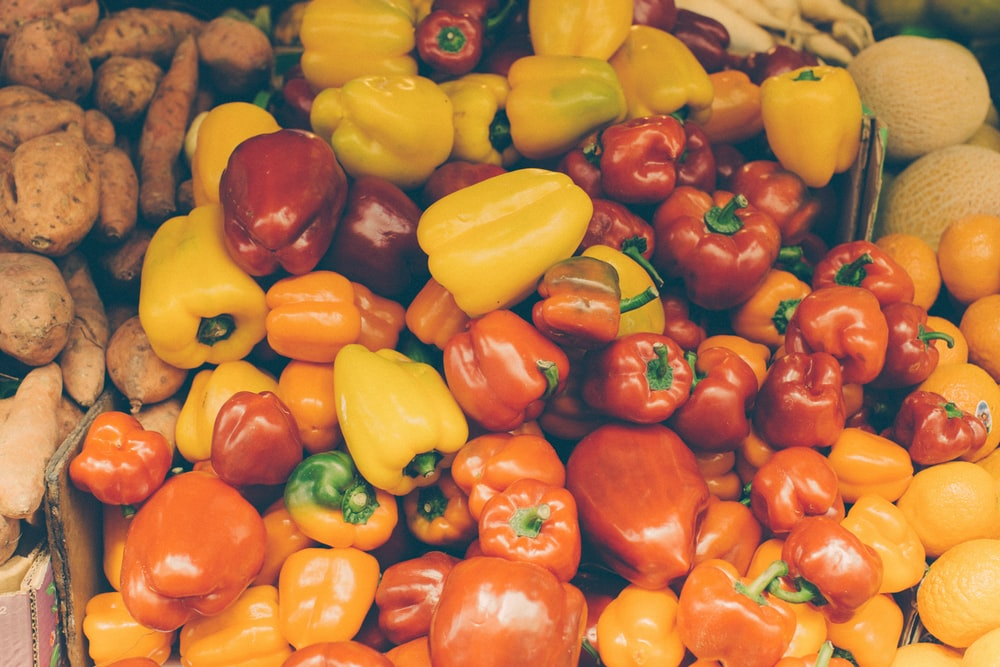 flat lay photography of bunch of yellow and red bell peppers