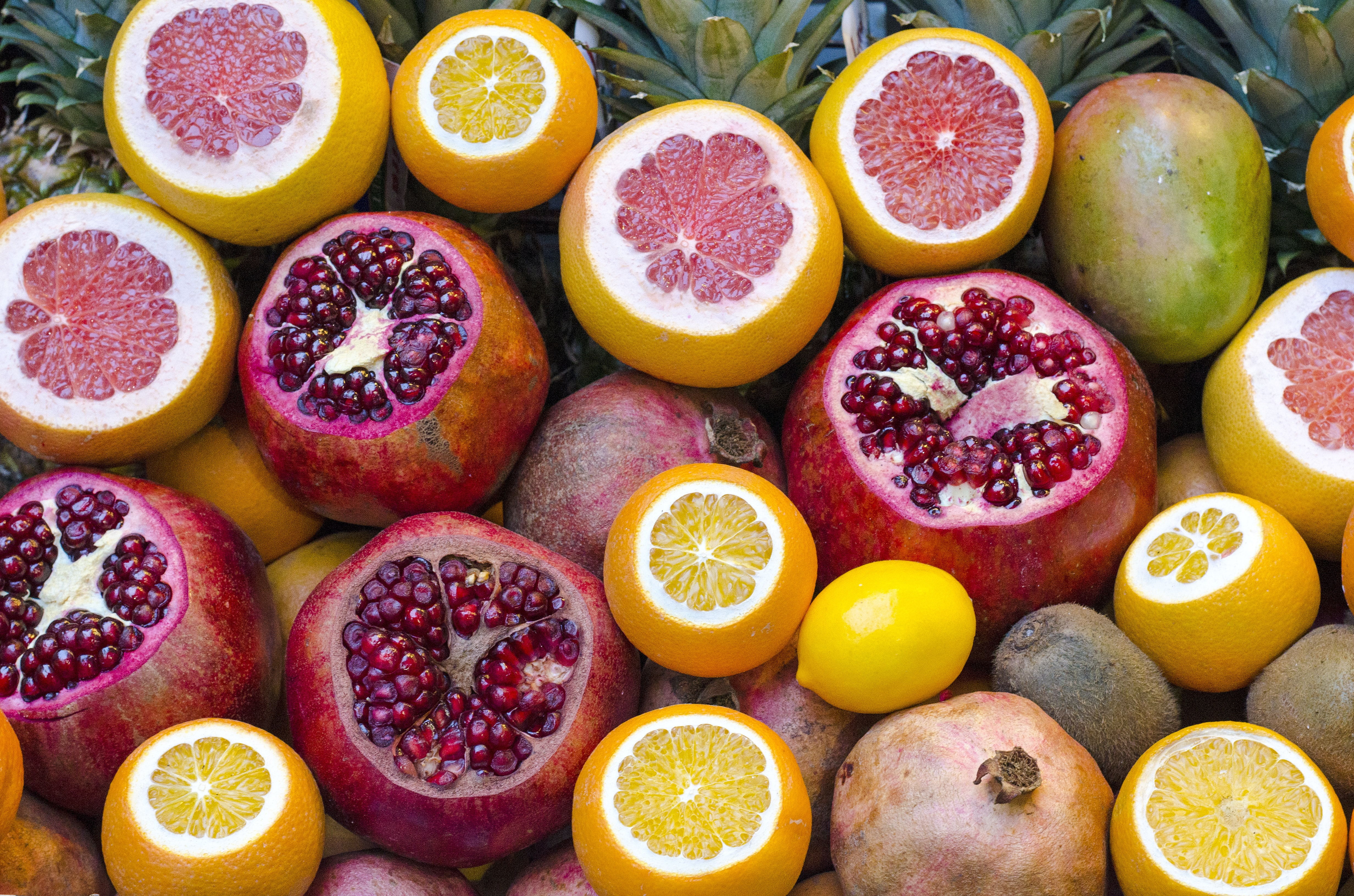 Mango, grapefruit, pomegranate, and tropical fruit sliced open