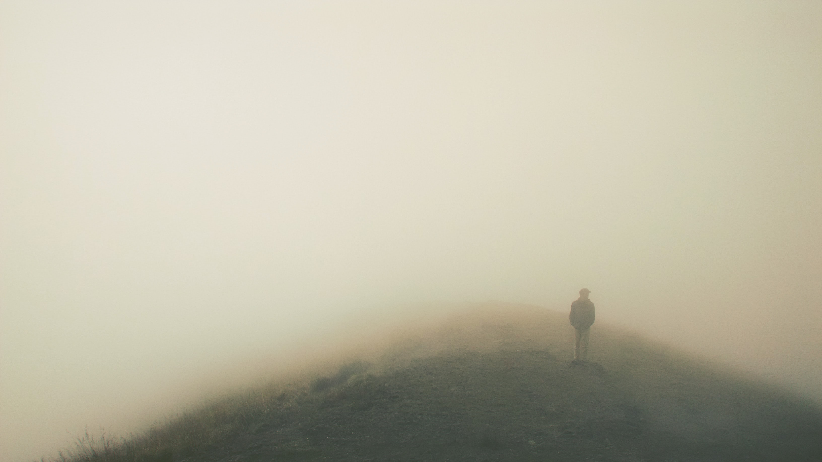 A person standing inside of a cloudy foggy area on top of Mt. Penanggungan