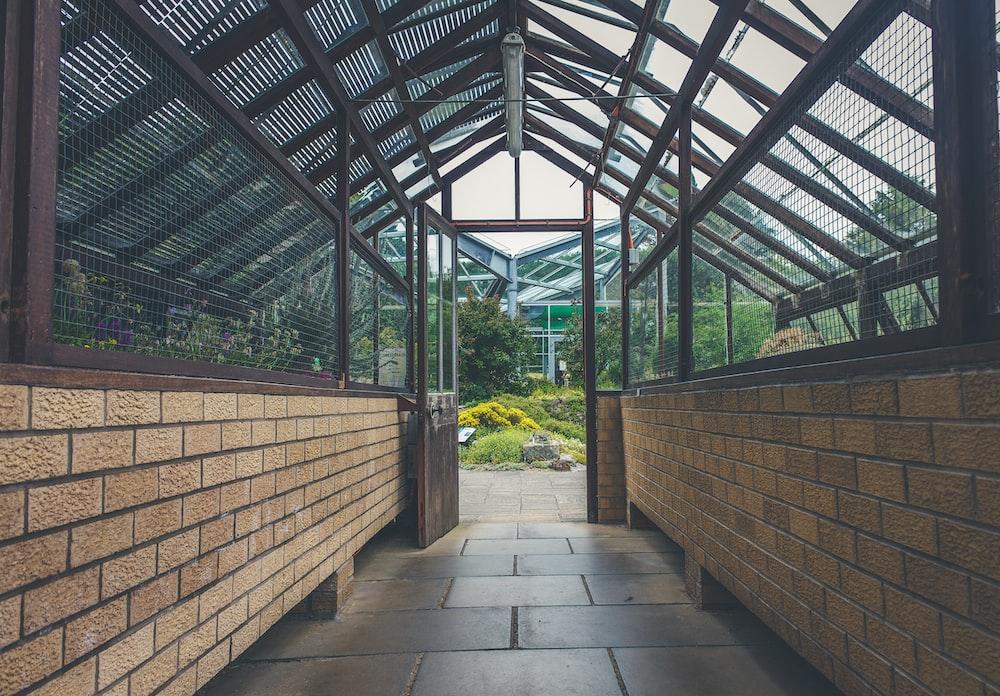 brown tiled hallway indoor photo