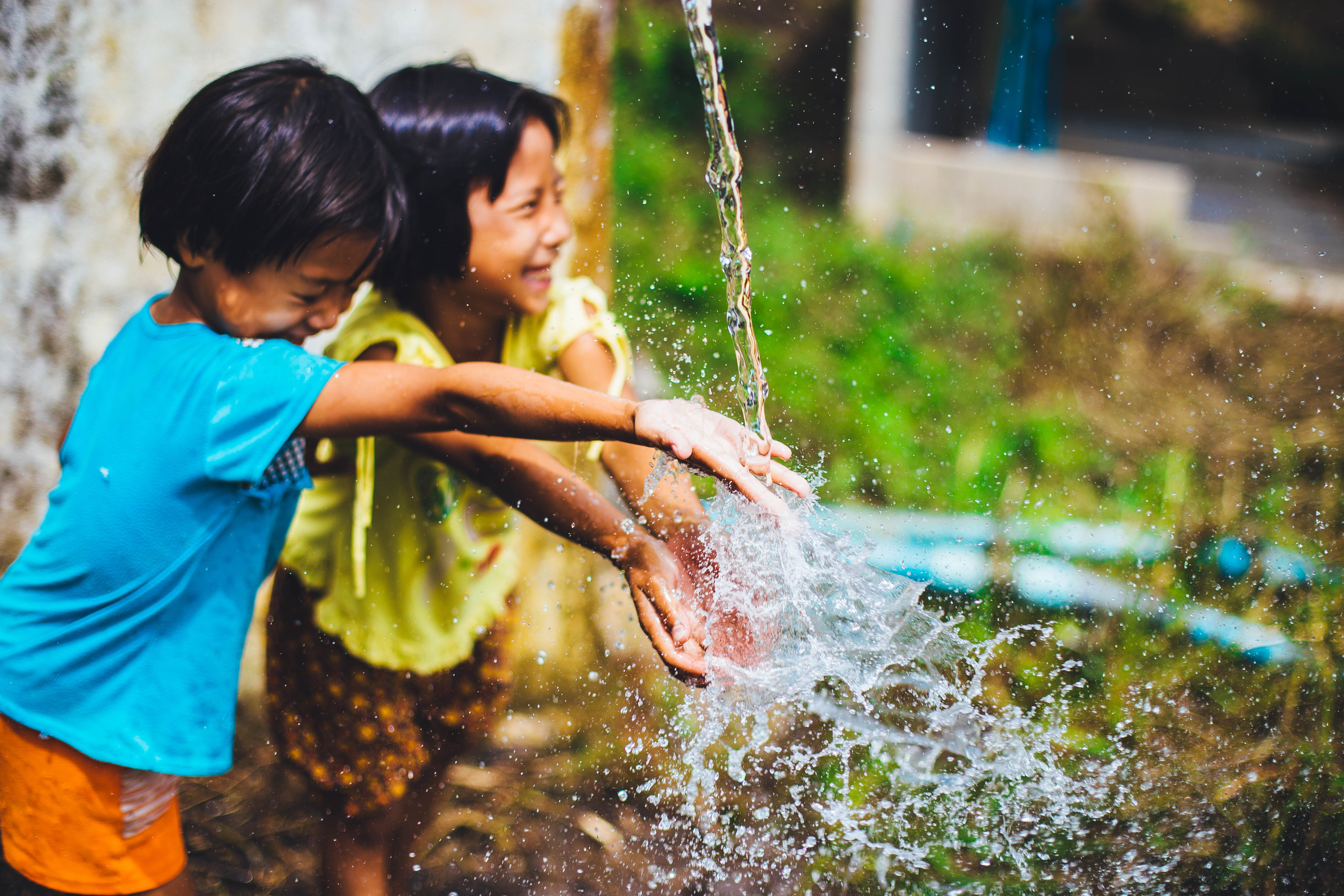 two girl playing water