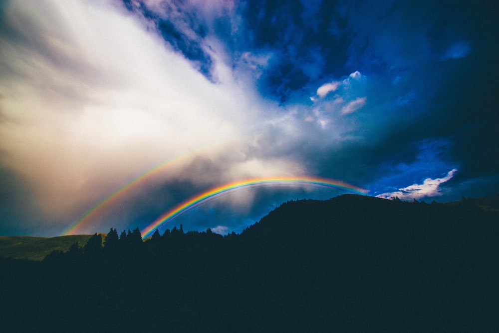 A Mountain Silhouette With Double Rainbow In The Blue Sky Provo