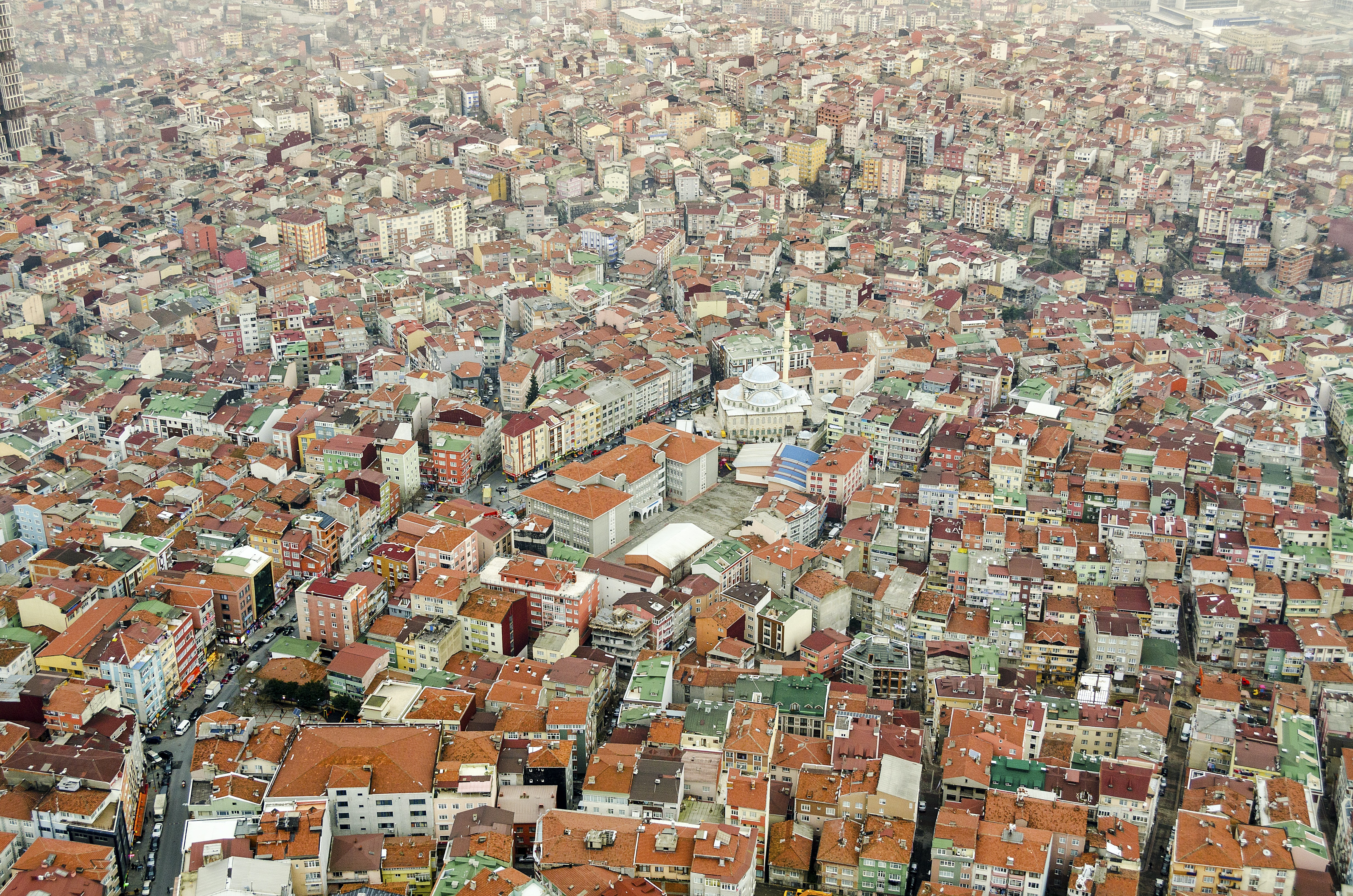 Aerial view of a town full of houses with clay tile roofs