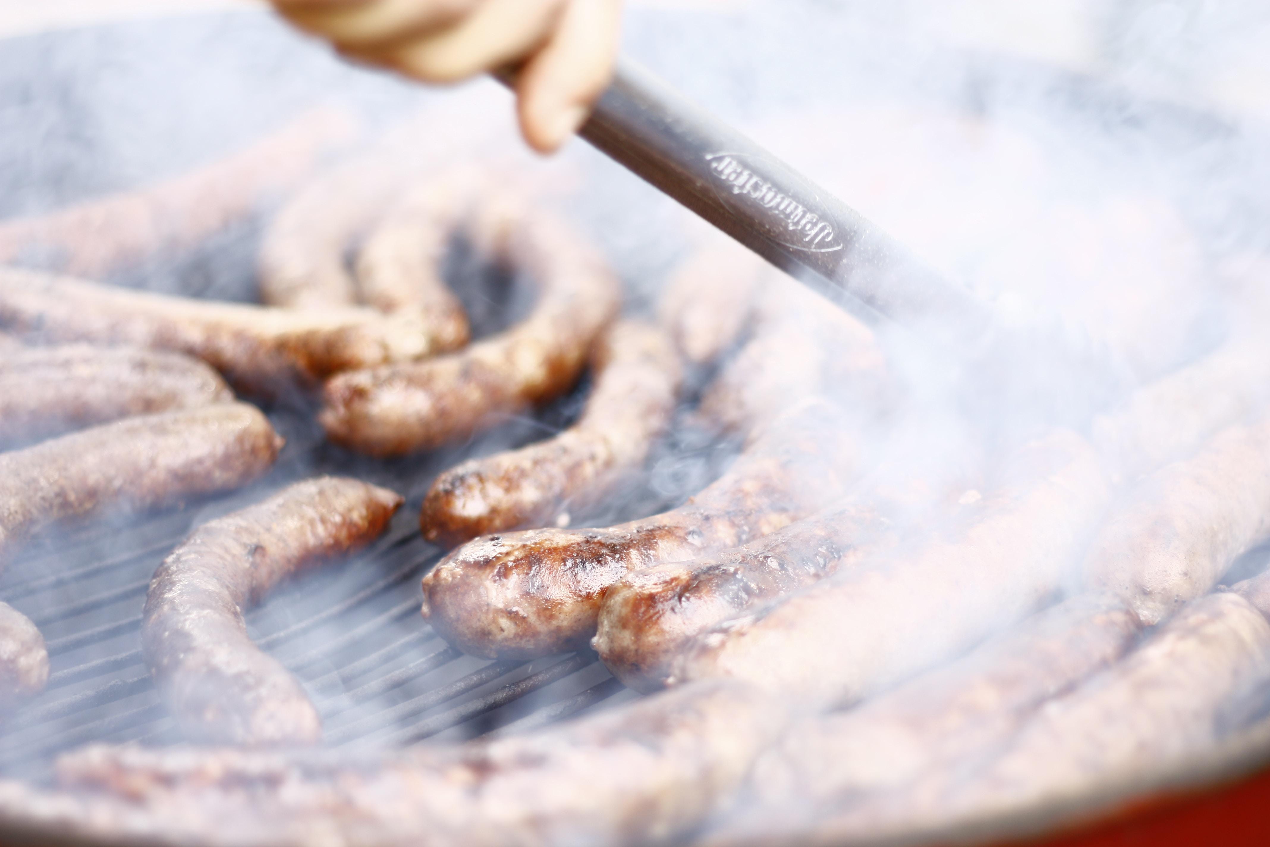 grilling sausage during daytime