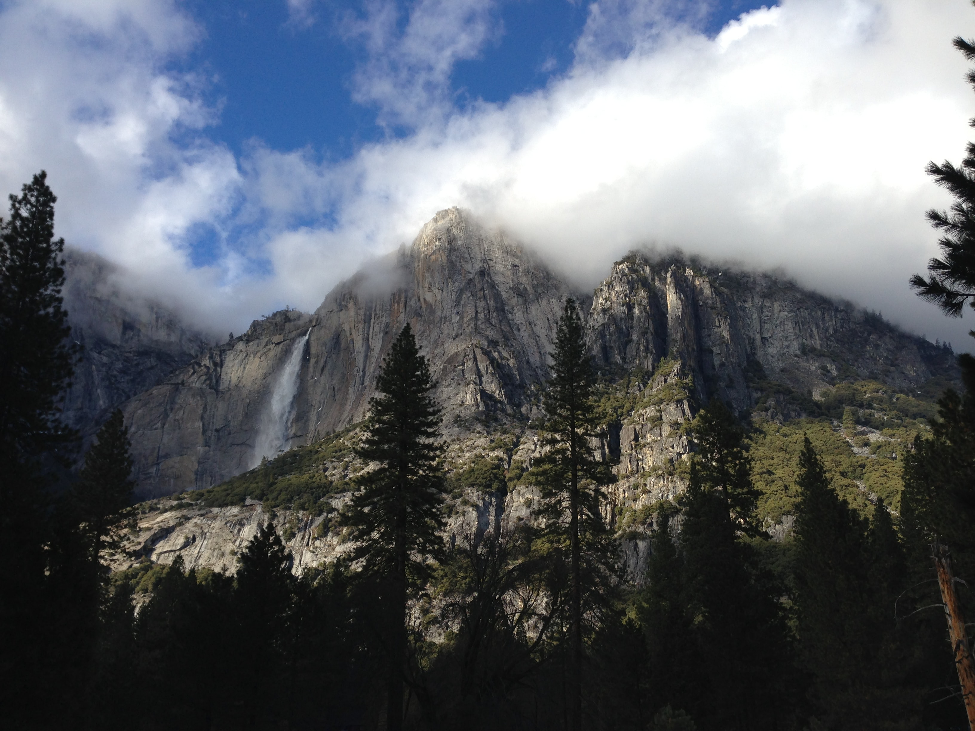 A waterfall pouring down a granite cliff in Yosemite