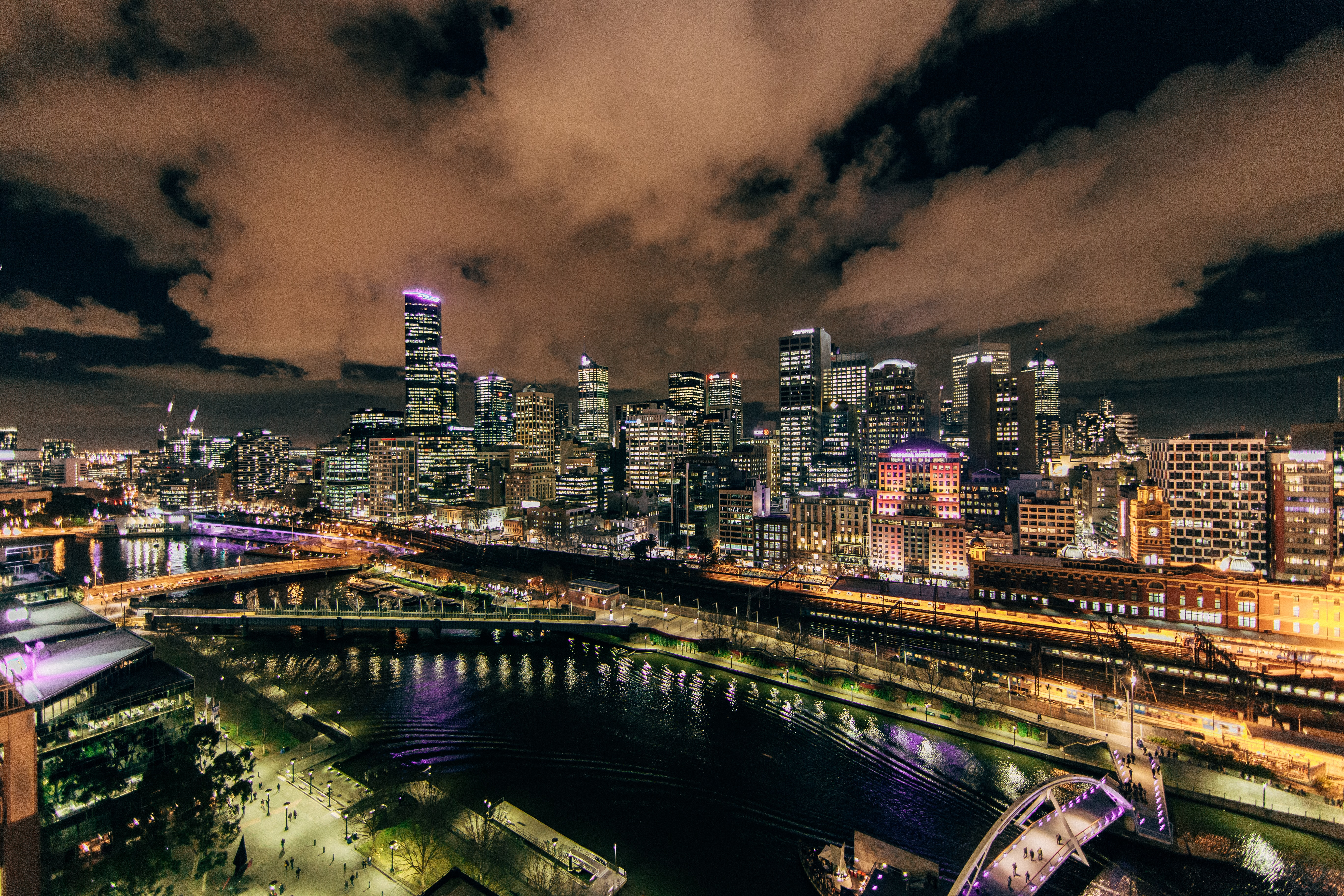 An urban panorama on the banks of a river in Melbourne at night