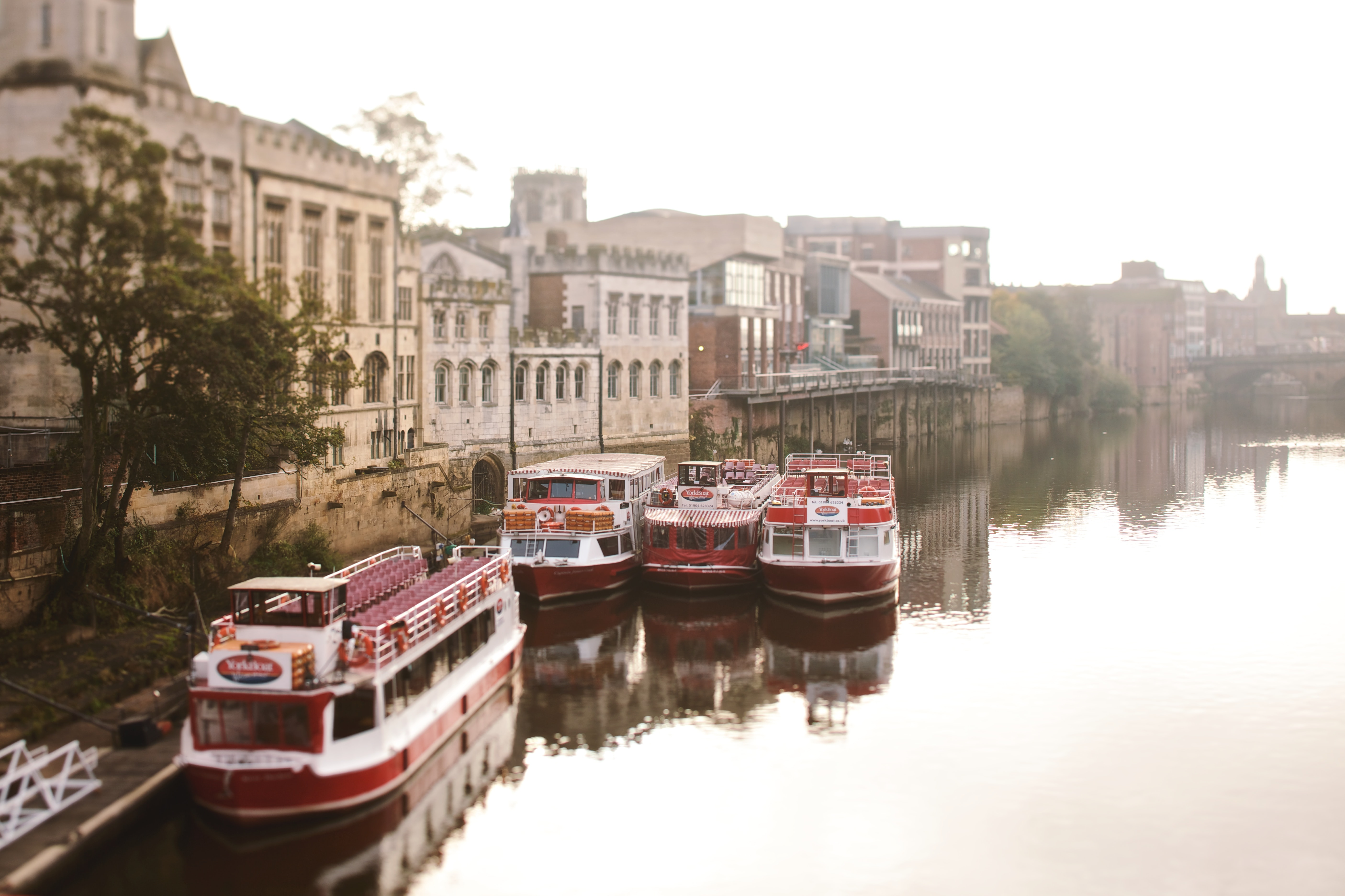 Double decker boats docked along the river in historic York