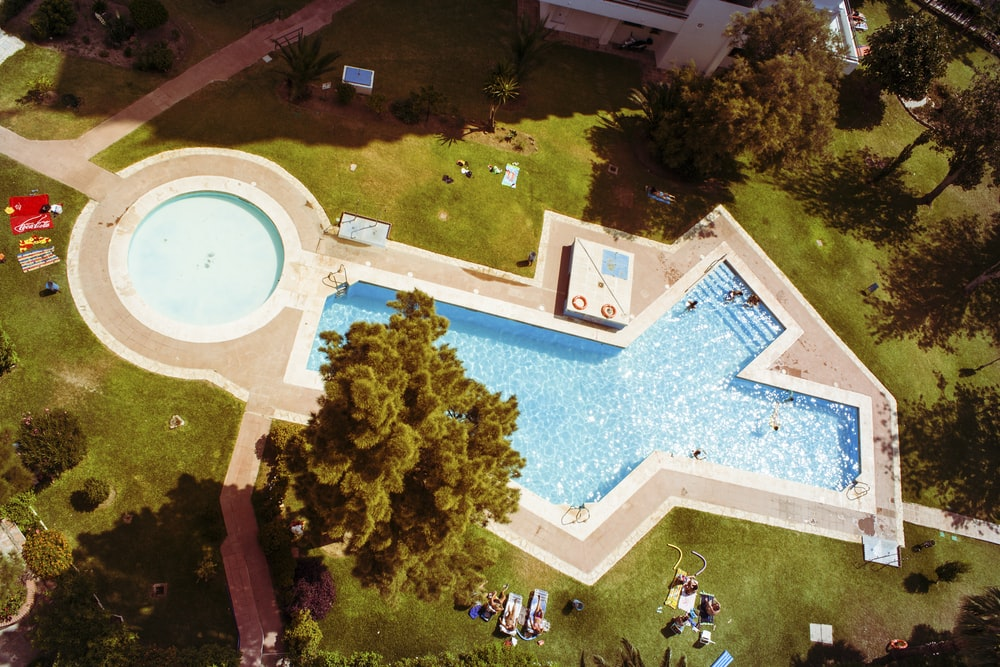 aerial shot of white and blue swimming pool
