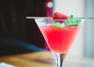 selective focus photography of filled martini glass