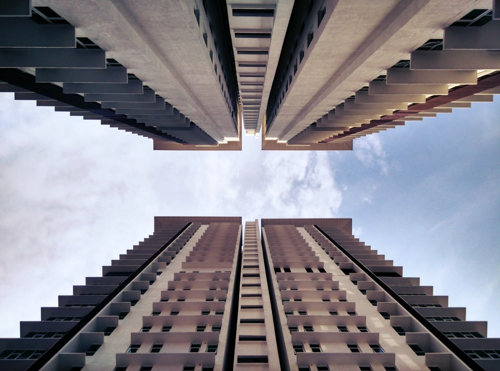 low-angle photography of two buildings