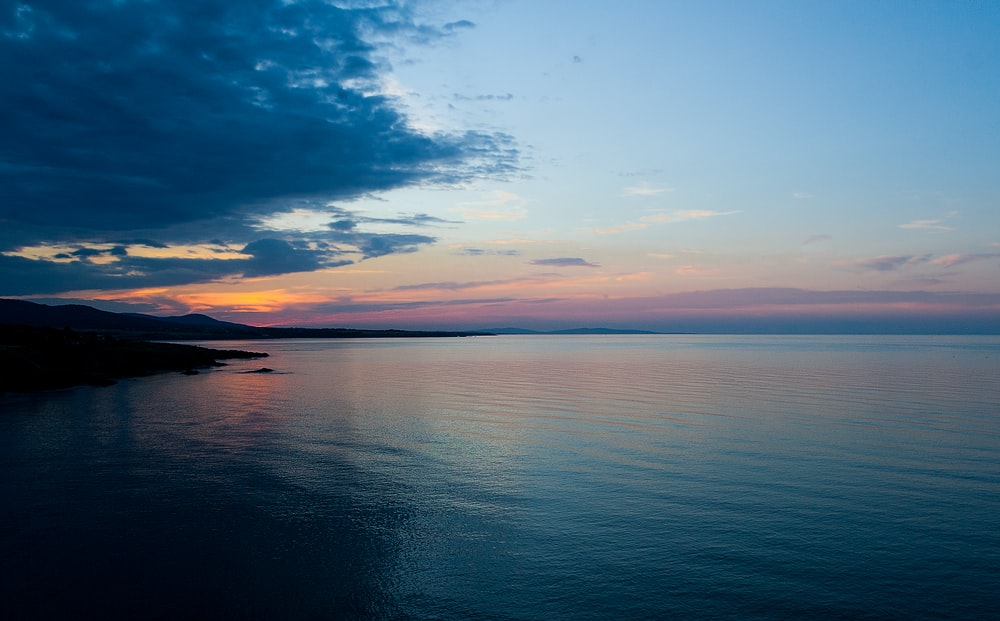 body of water during sunset landscape photography