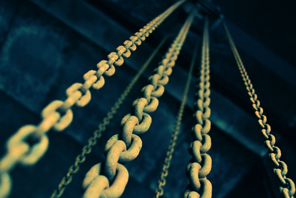 low angle photography of gray metal chains