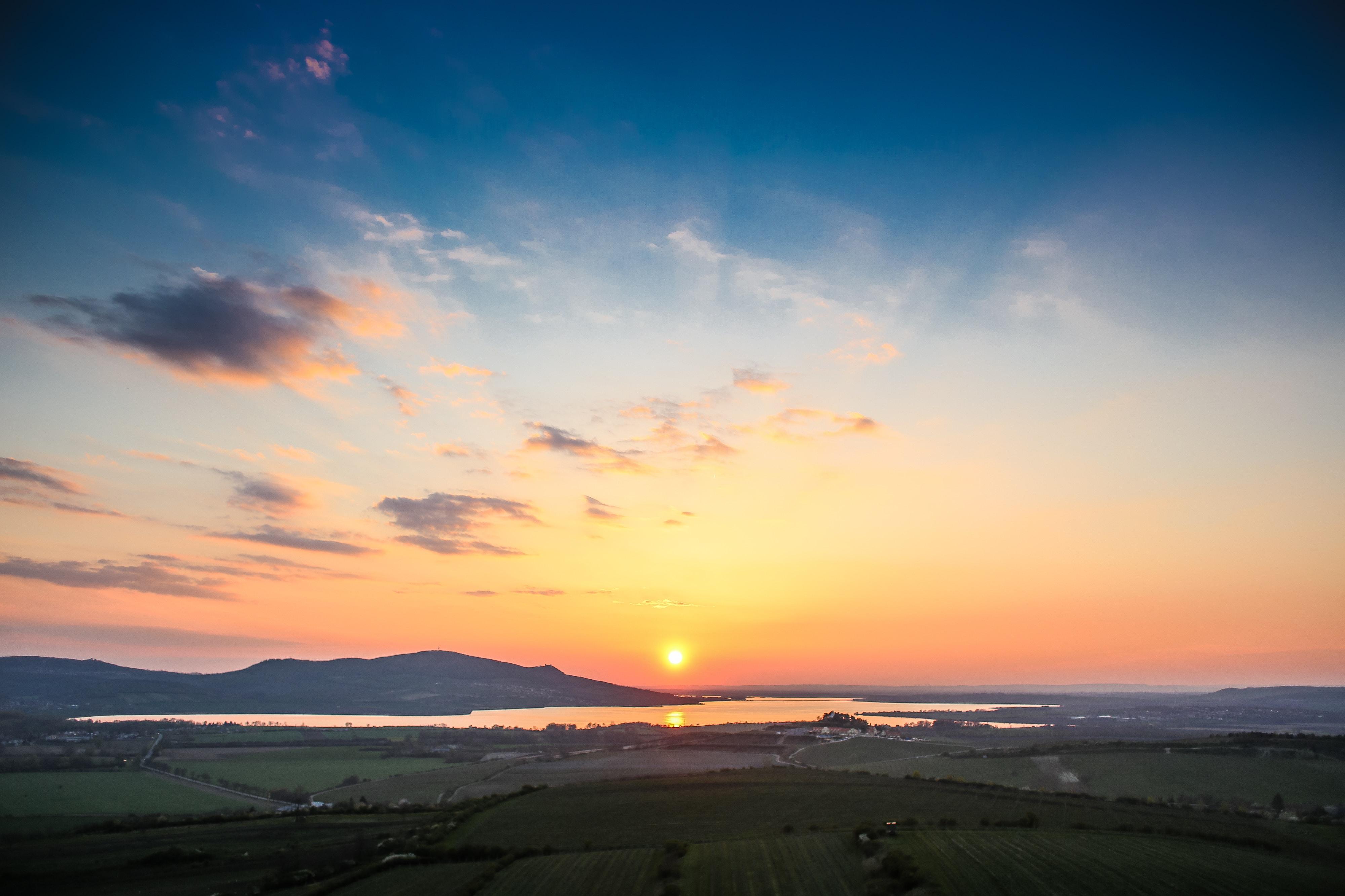 bird's-eye view photo of landscape field during golden hour
