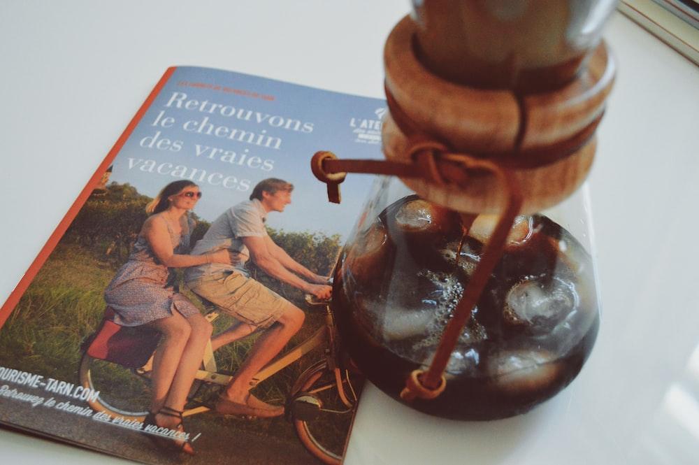 Retrouvons Ic Chemin book beside cork bottle