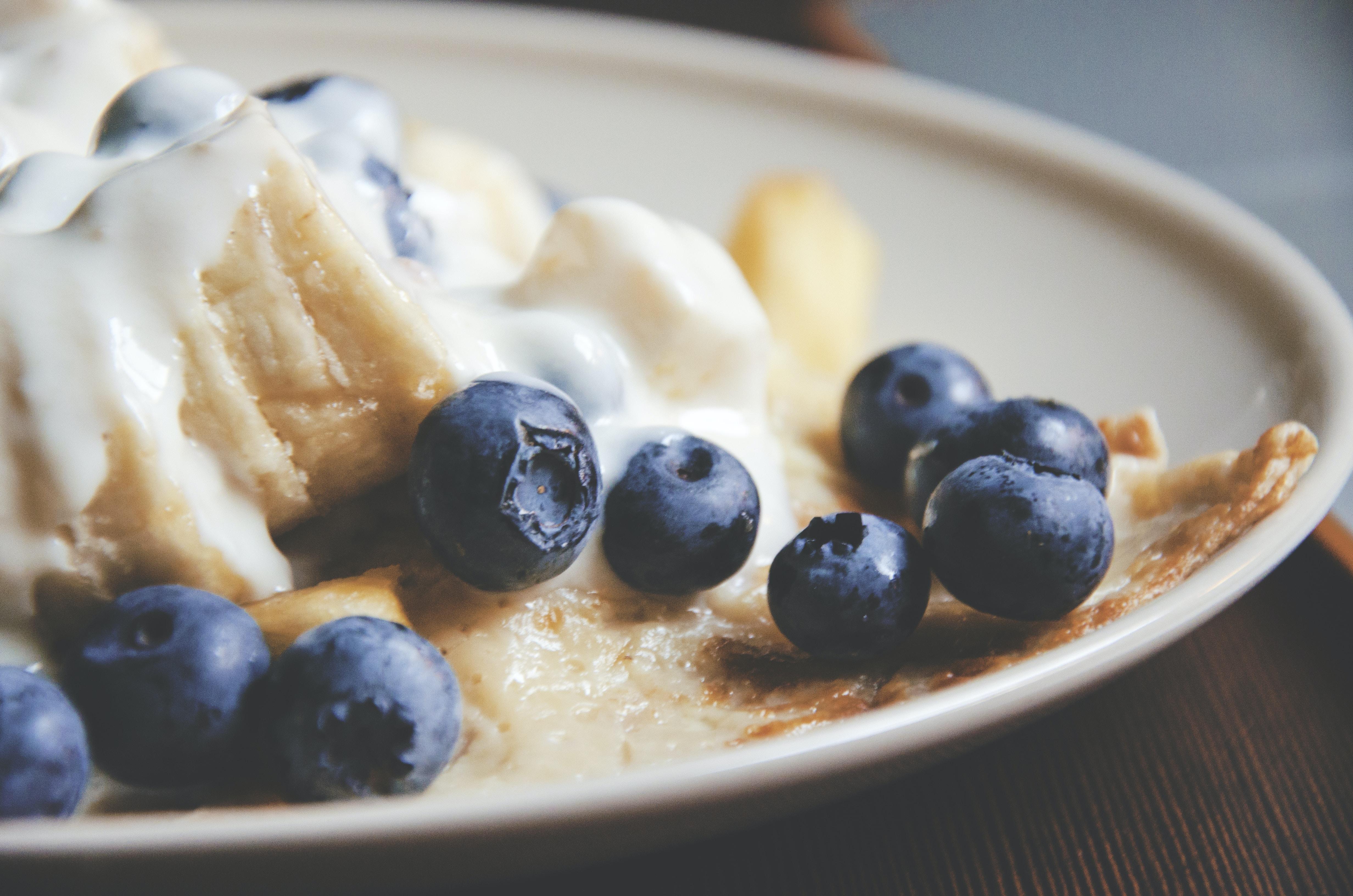 Macro shot of blueberries and yogurt on a homemade dessert tart