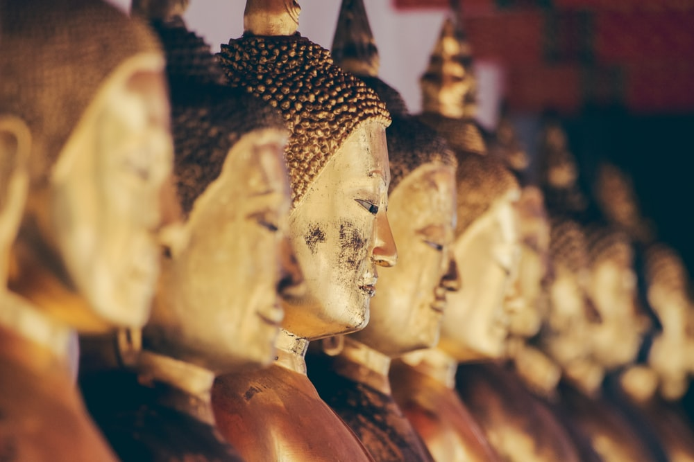 brass Gautama statue in tilt shift photography