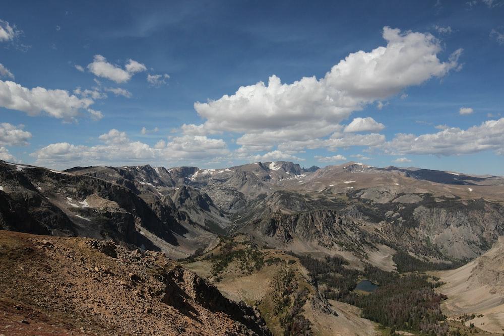 brown mountain terrain under clear sky