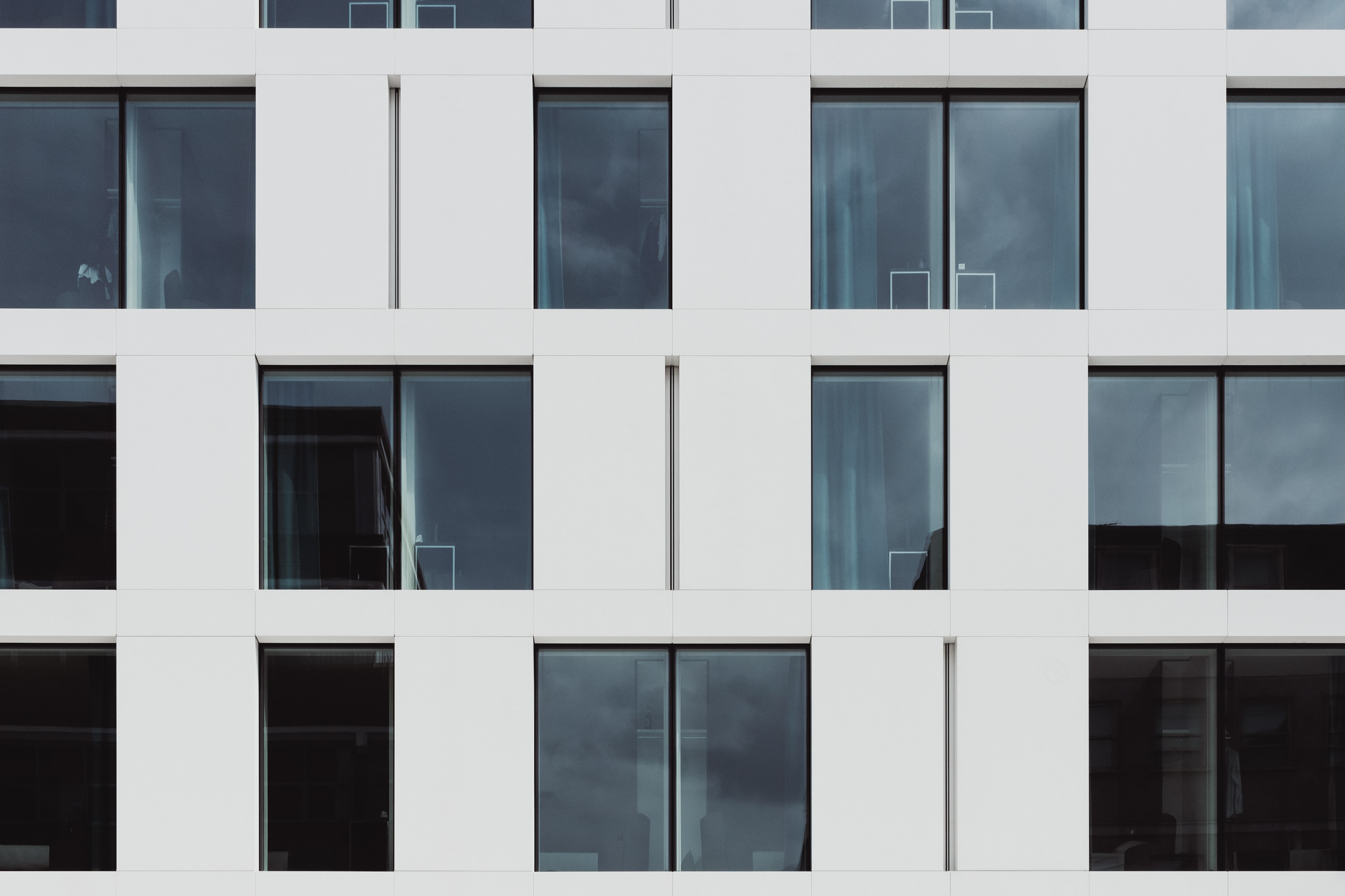Modern design windows on white walls of a building in London.