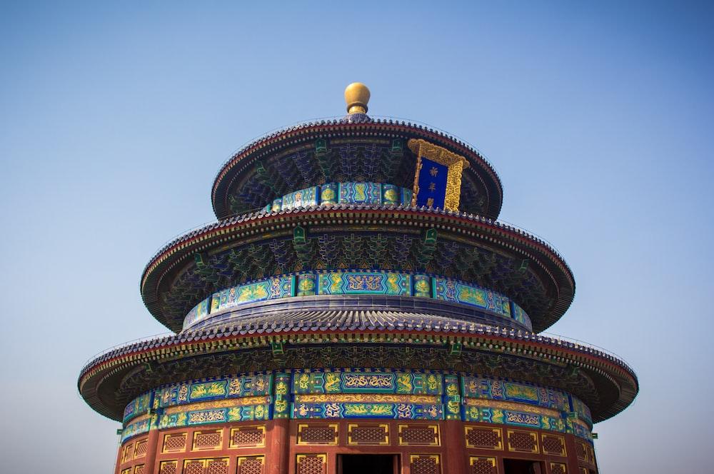 low-angle photography of 3-tier pagoda