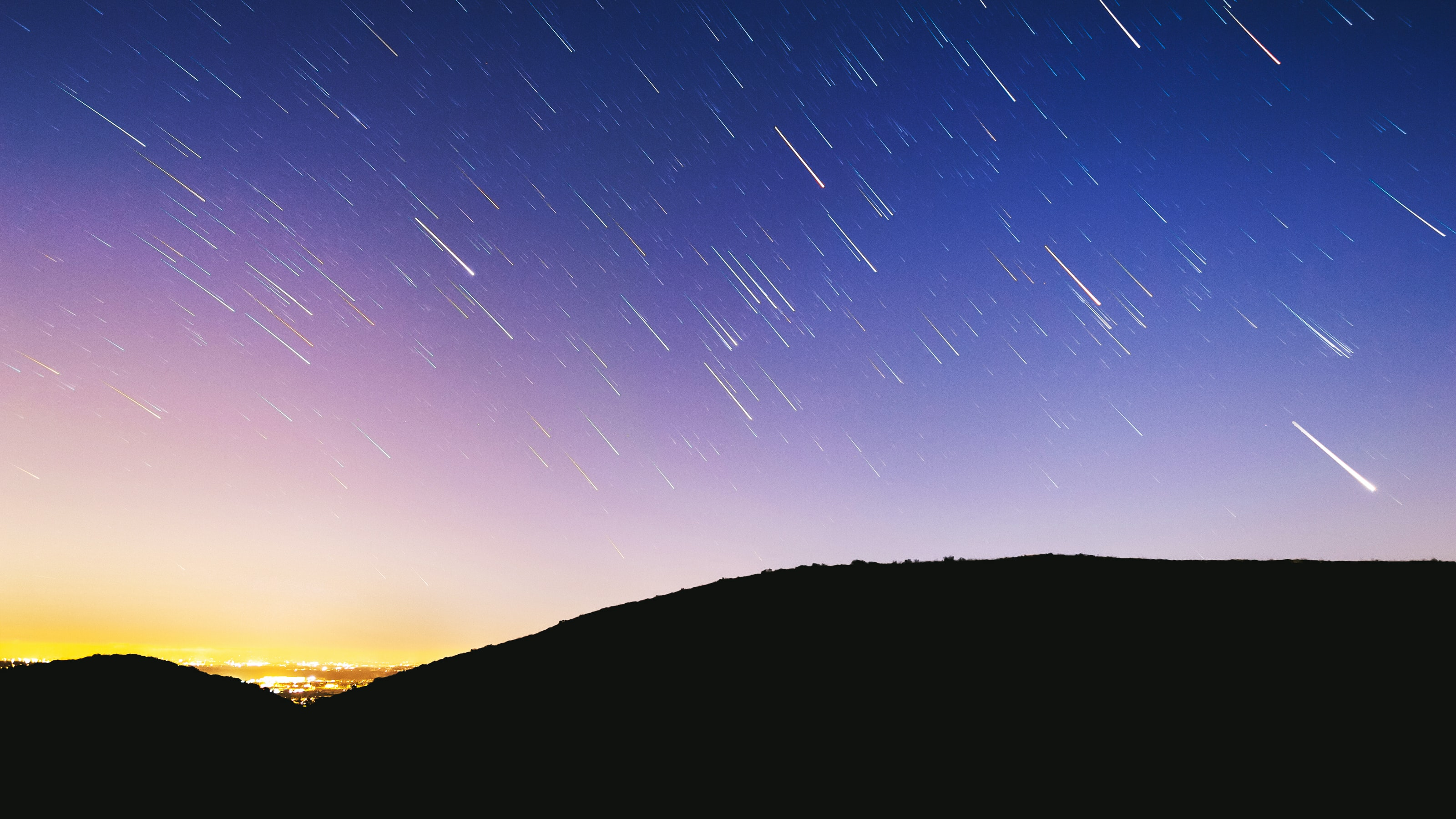 time lapse photography of shooting stars
