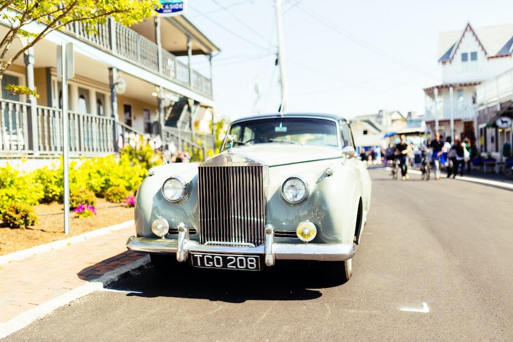 classic white vehicle on concrete road