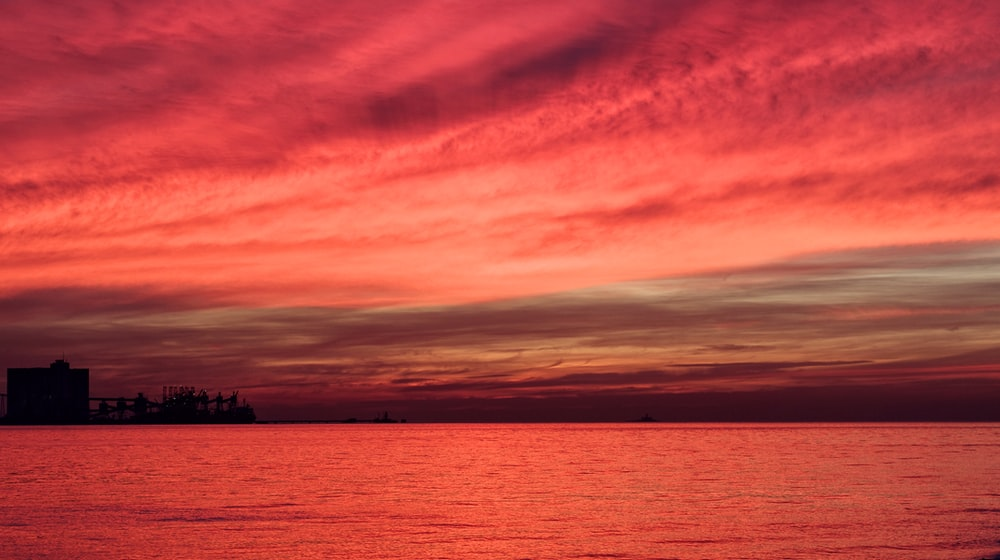 silhouette of structure under red sky