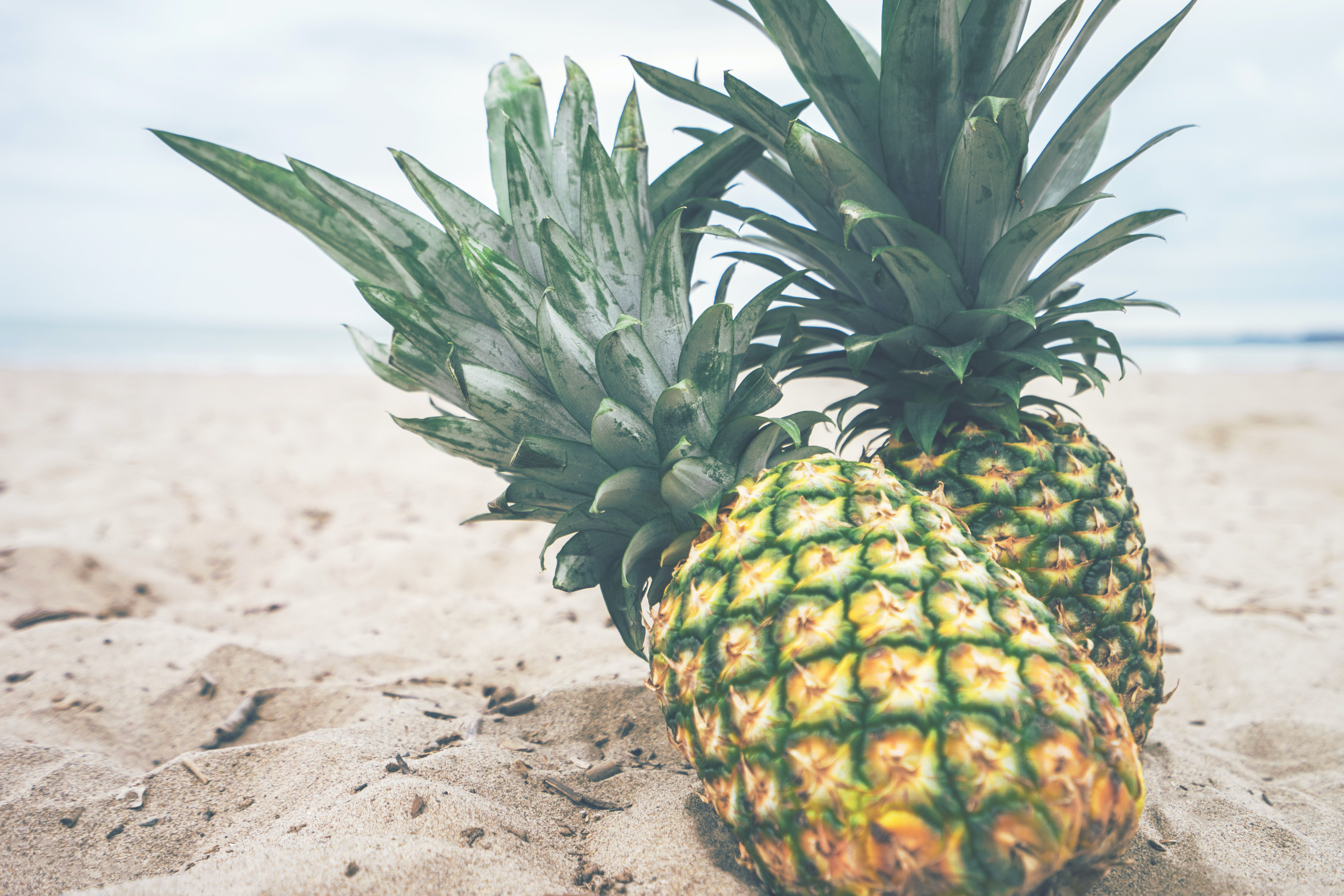 Two pineapples on a tropical beach