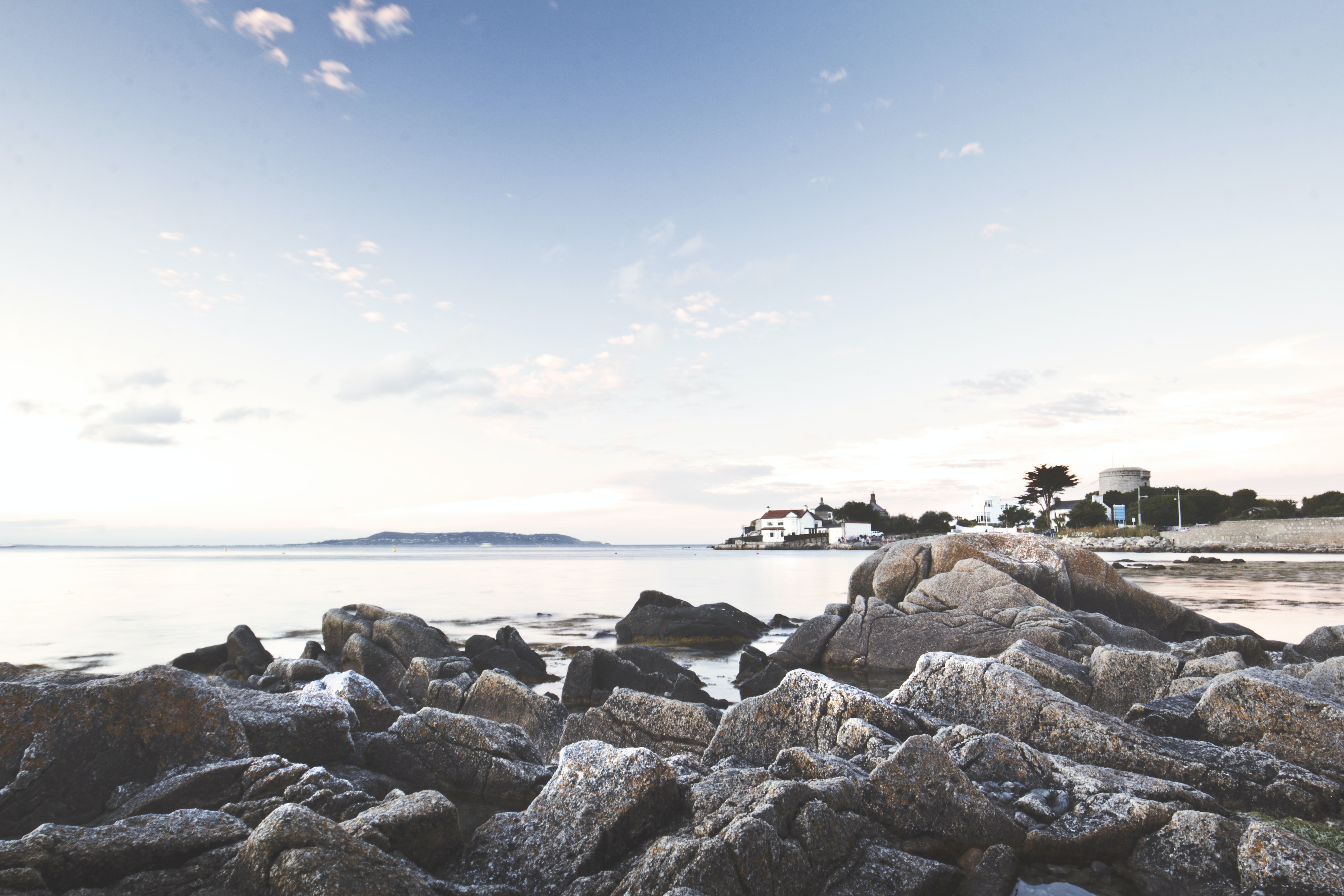 Coastal houses viewed from a rocky shore at Dún Laoghaire
