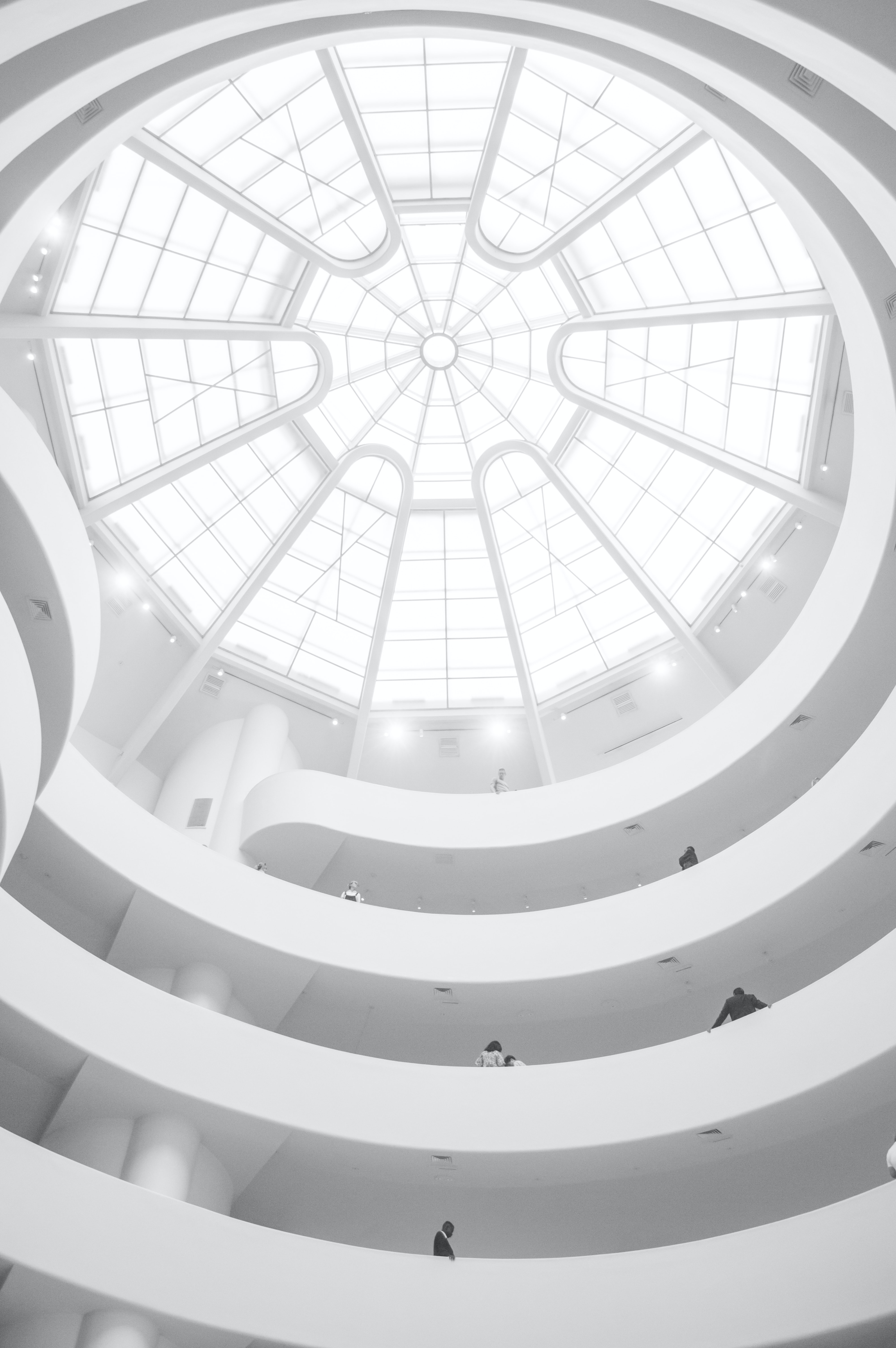 A white dome in the ceiling of a modern building
