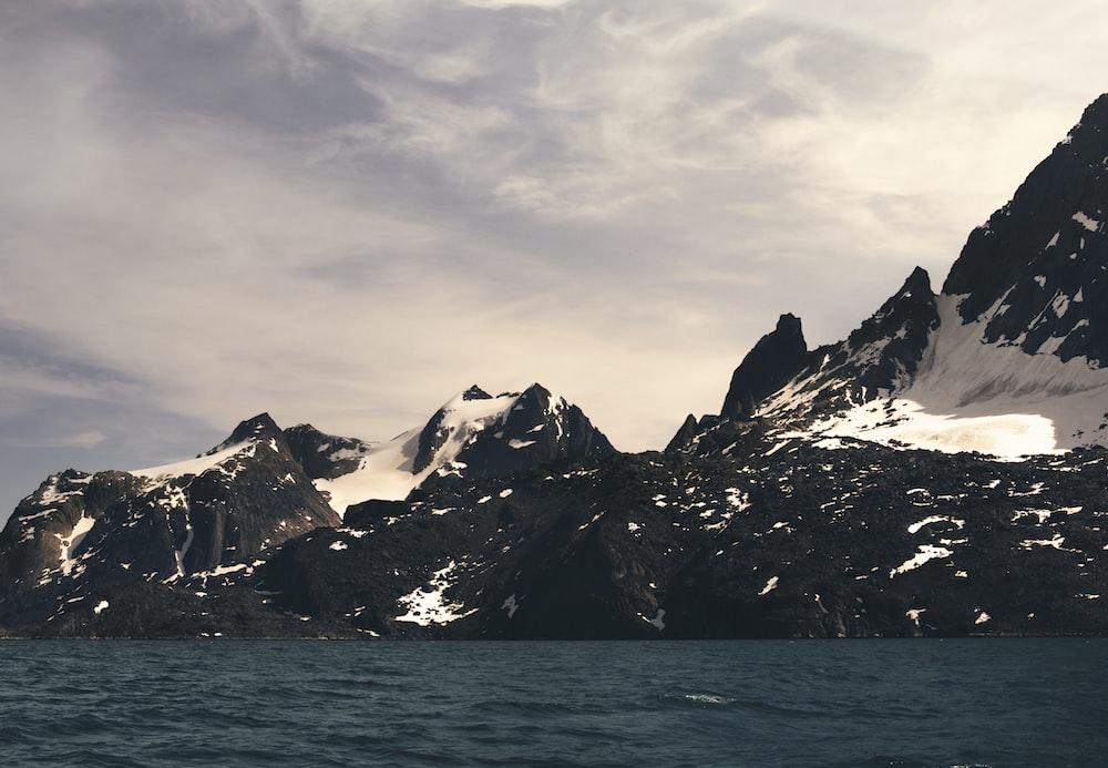 mountain alps near body of water