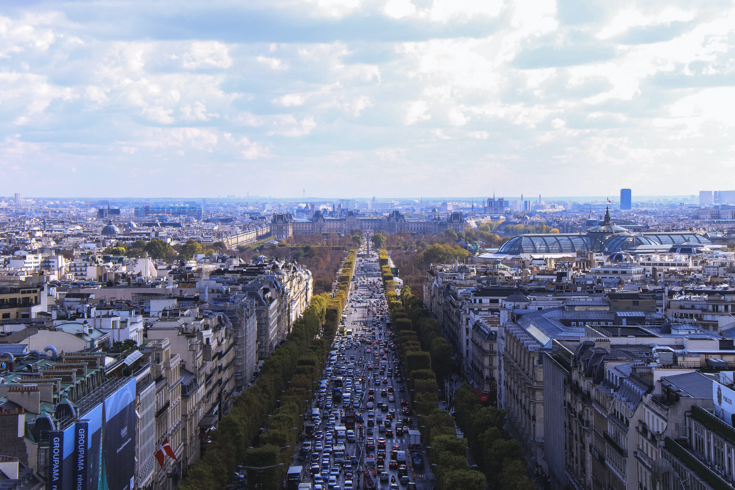 The cityscape of Paris, France with buildings and heavy street traffic.