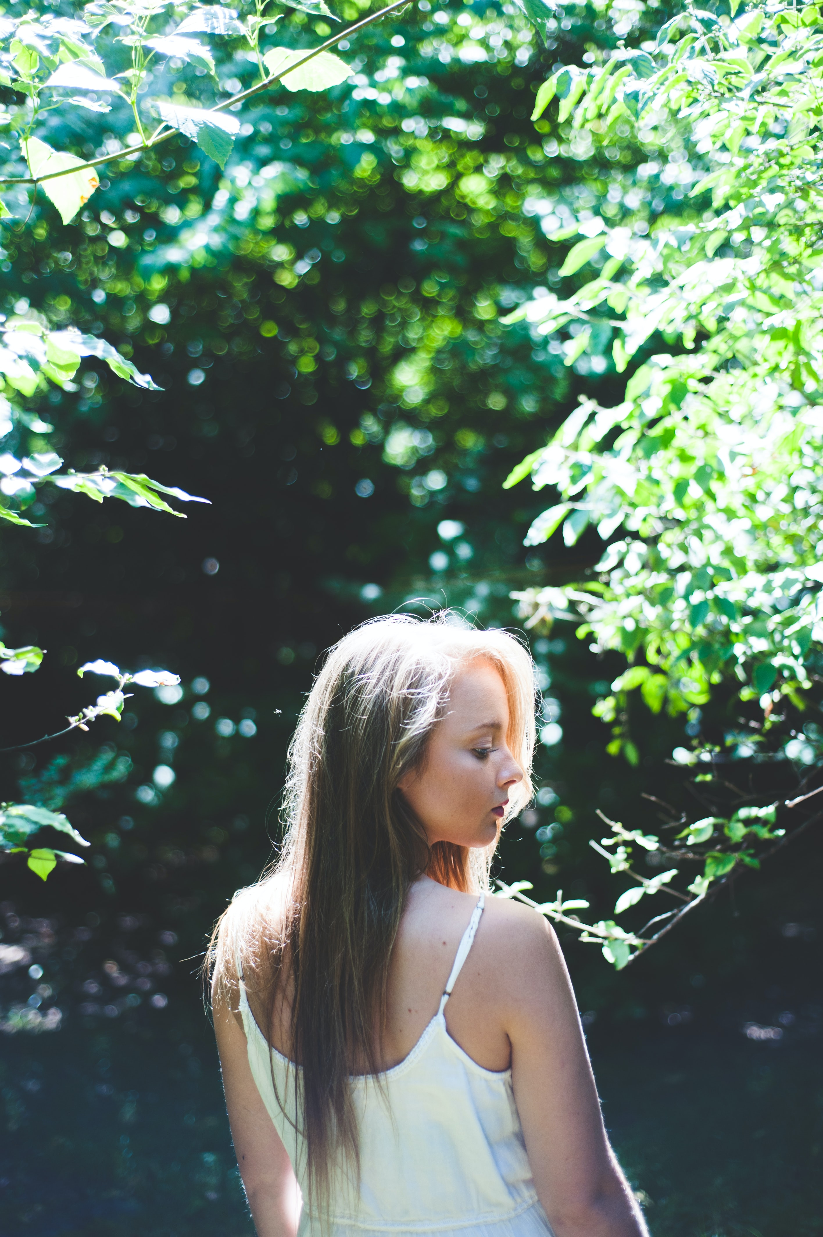 woman standing near tree during daytime