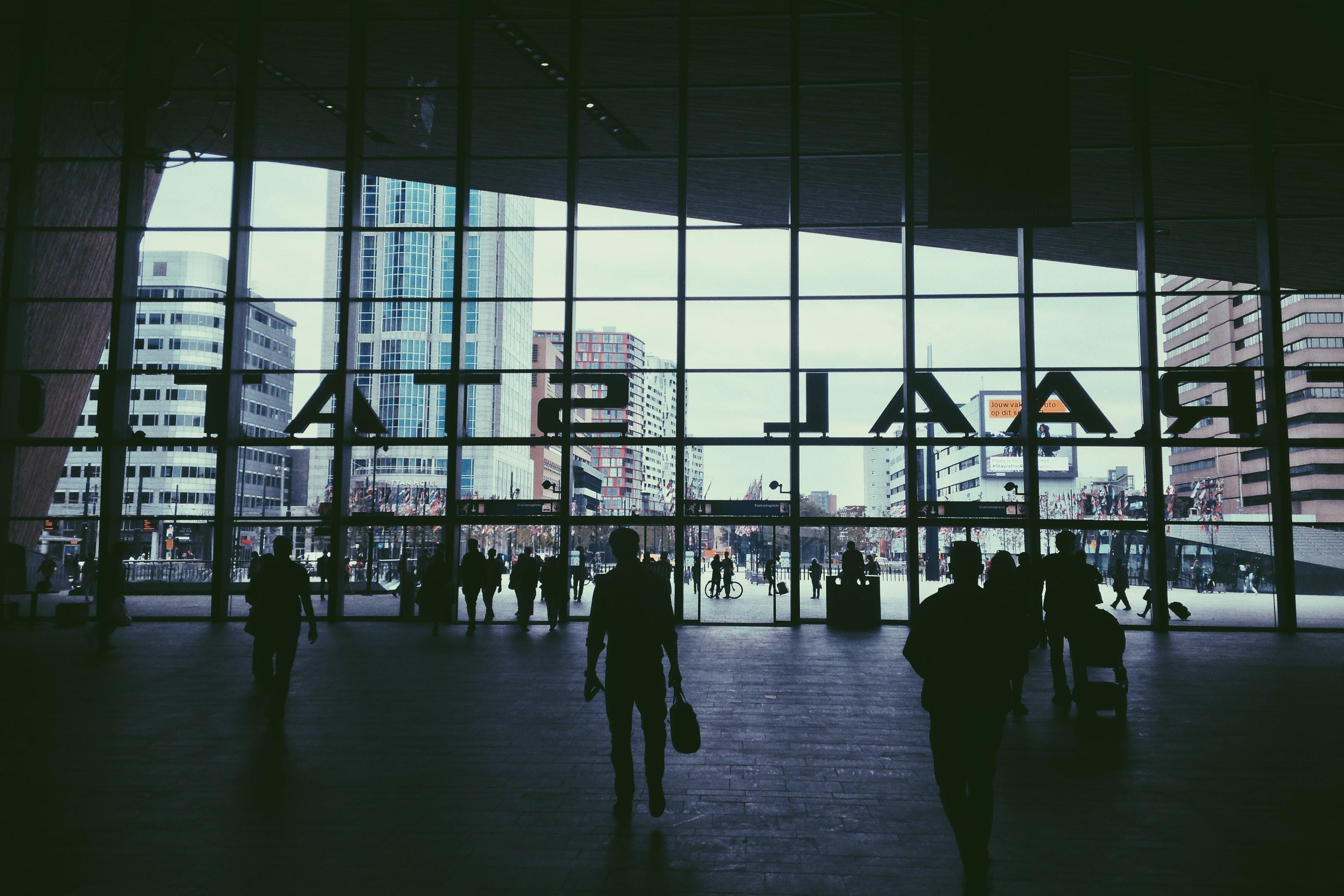 silhouette of people walking inside Raal Stat building