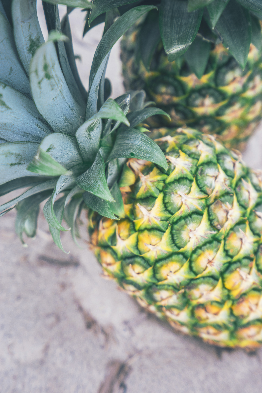 Fresh pineapple on a market sidewalk