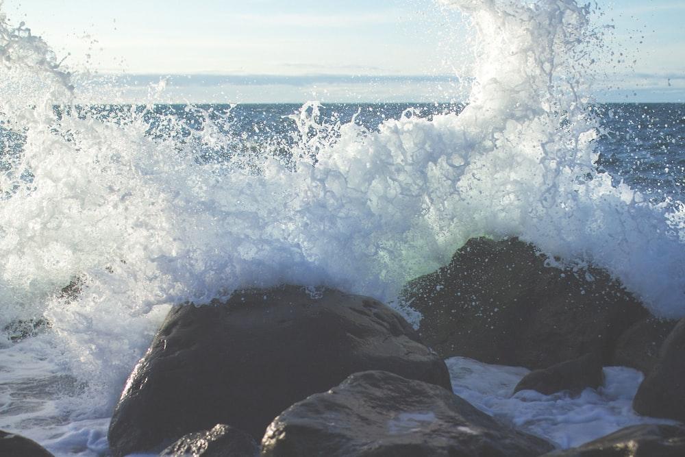 ocean waves in coastal rocks during daytime