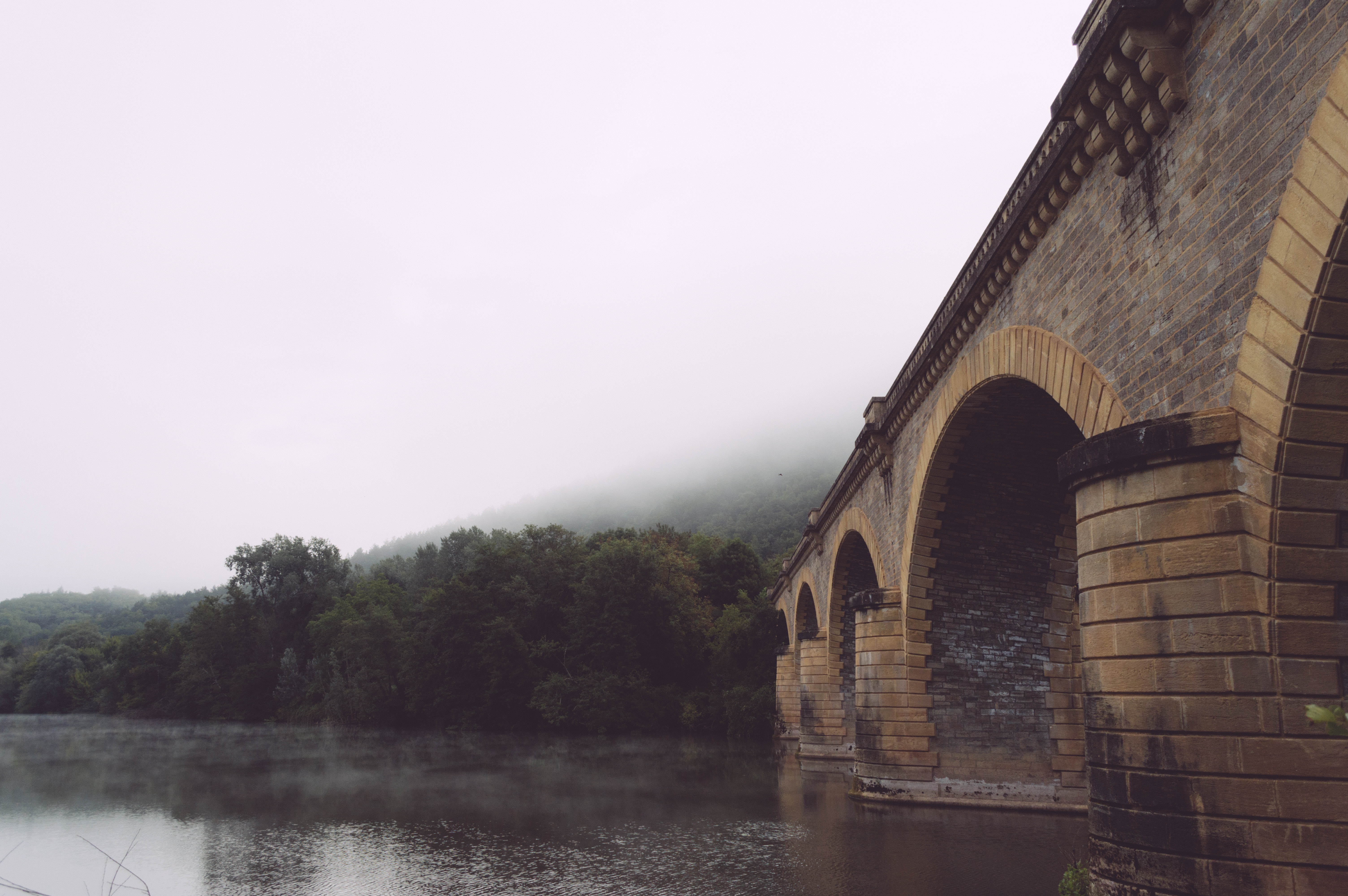 Brick archways in a bridge over a river