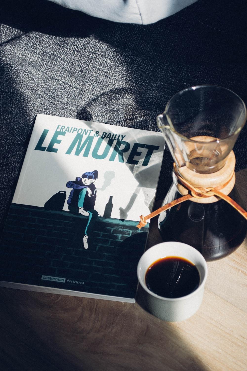 Le Muret book and white ceramic mug
