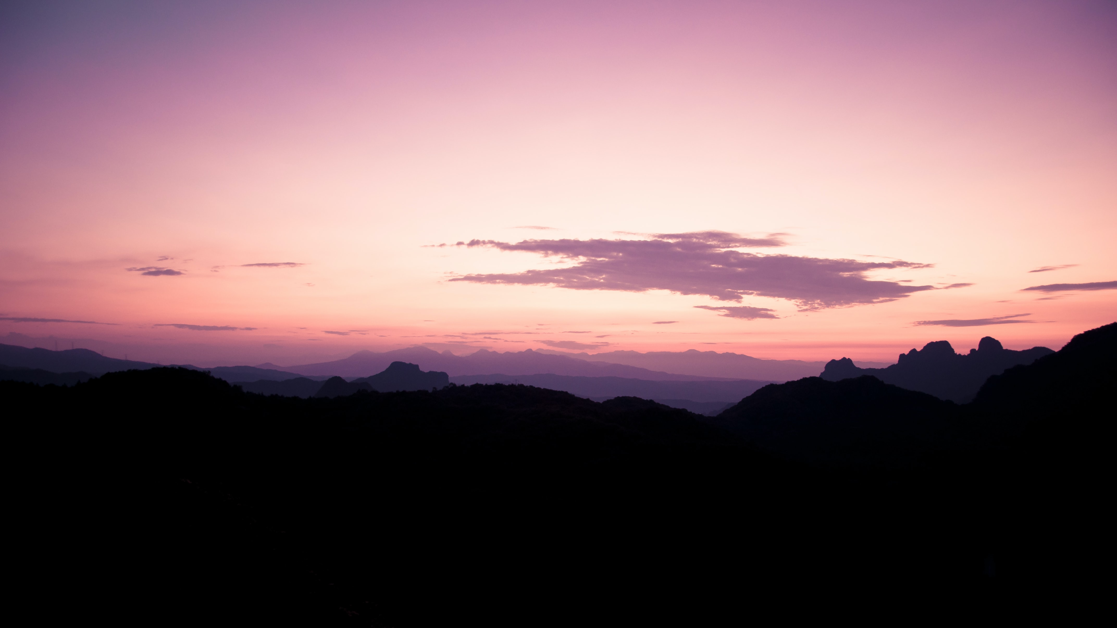 silhouette of mountain at golden hour