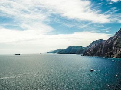 blue body of water amalfi coast teams background