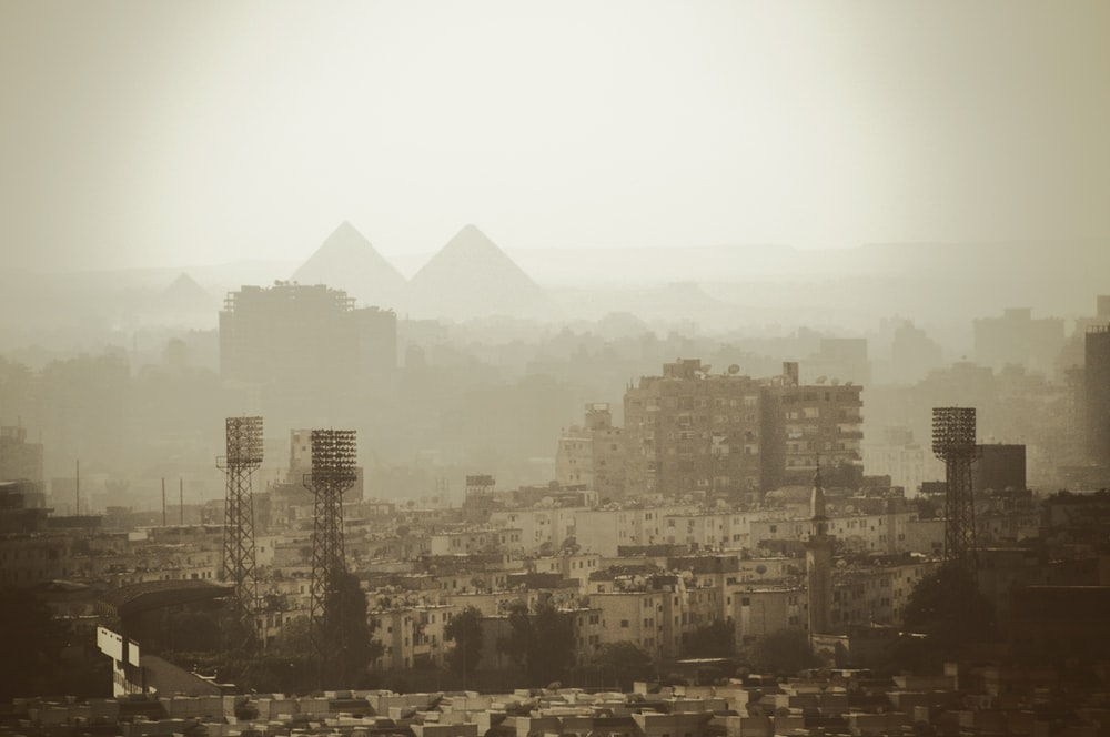 aerial photo of gray buildings near pyramids