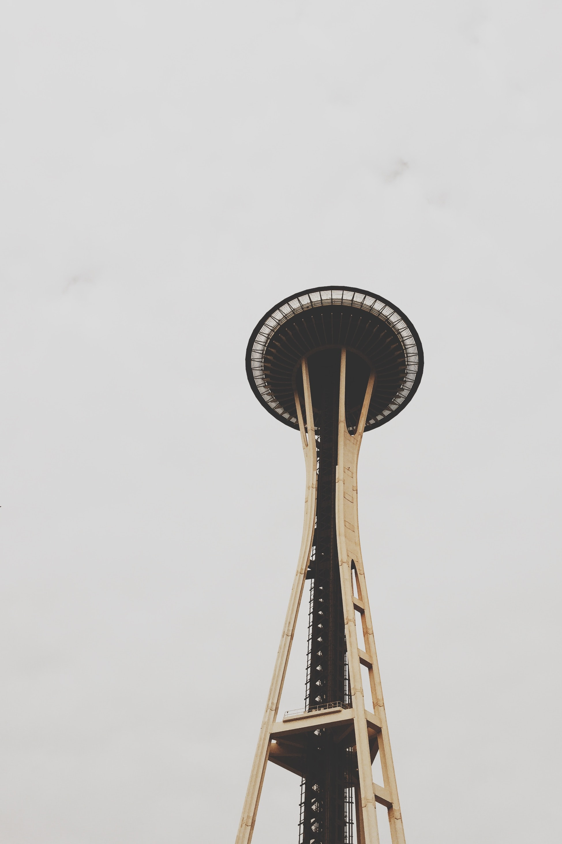The Space Needle observation tower in Seattle against a white sky