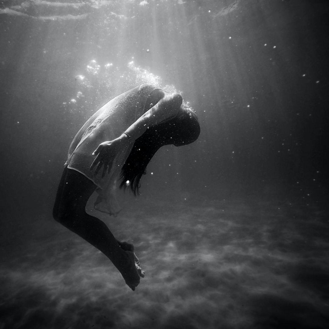 woman underwater in dress