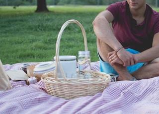 man sitting near basket