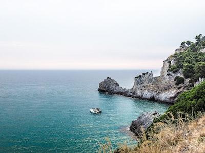 two boats near stone island during day amalfi coast teams background